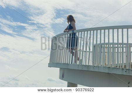 Woman On Foot Bridge In Summer