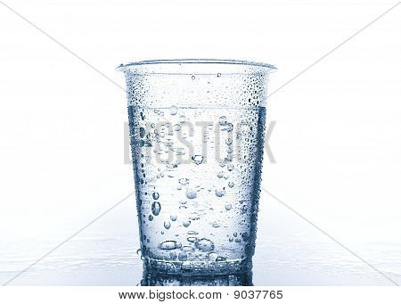 Plastic Cup With Water On White Background
