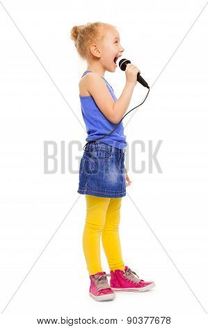Small girl in colorful clothes singing alone