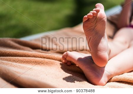 Feet of toddler on beach