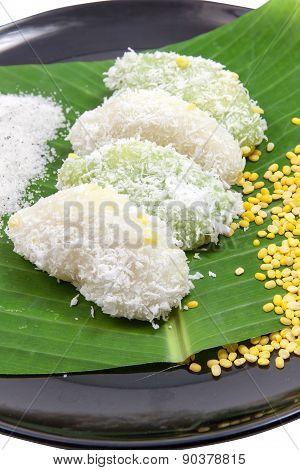 Close Up Mung Bean Rice - Crepe On Banana Leaves And Black Ceramic Dish Vertical