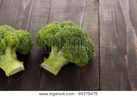 Fresh Green Broccoli On The Wooden Background