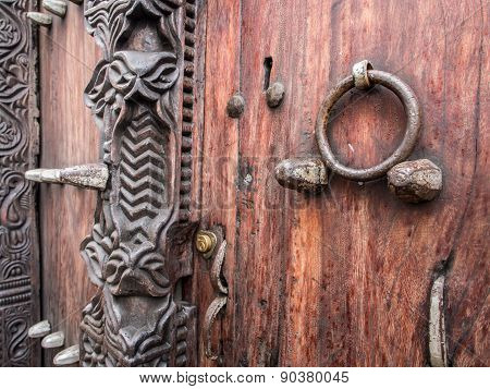 Traditional wooden carved door in Stone Town, Zanzibar,