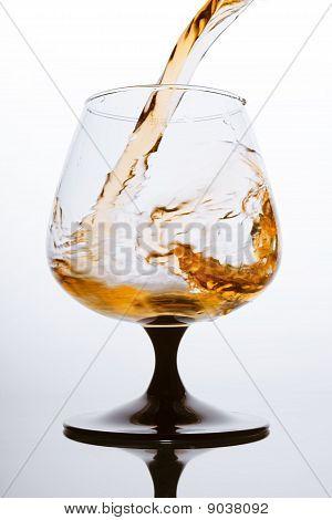 Brandy Pouring, Fiery Splash In Glass