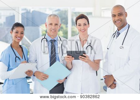 Team of doctors working together on patients file in medical office