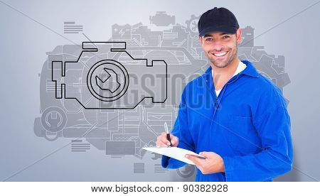 Handyman in blue overall writing on clipboard against grey vignette
