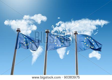 EU flags against world map made of white puffy clouds on blue sky