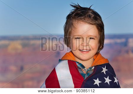 Boy with Grand Canyon National Park and USA flag