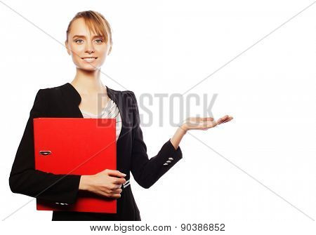 Business, finance and people concept: young business woman holdong folders and shows something, over white background