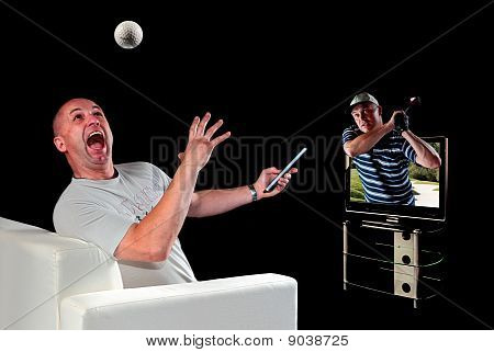 Man Watching Golf On 3D Television