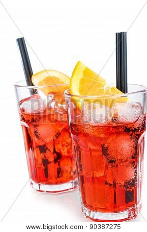 Two Glasses Of Spritz Aperitif Aperol Cocktail With Orange Slices And Ice Cubes Isolated On White