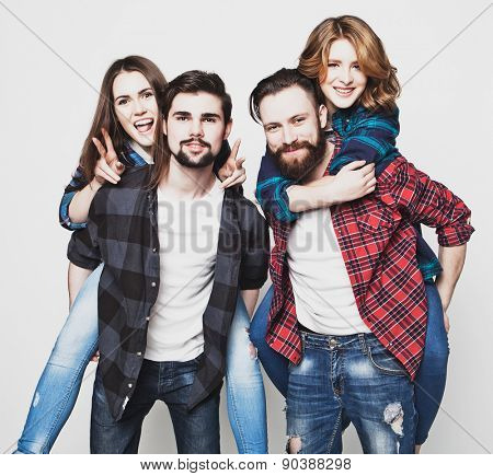 emotional, happiness and people concept: Group Of Young People Giving Piggybacks over white background.Special Fashionable toning photos.