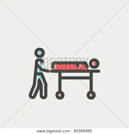 Man pushing the stretcher with sick person icon thin line for web and mobile, modern minimalistic flat design. Vector icon with dark grey outline and offset colour on light grey background.