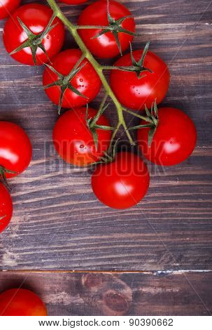Red Cherry Tomatoes On The Wooden Background