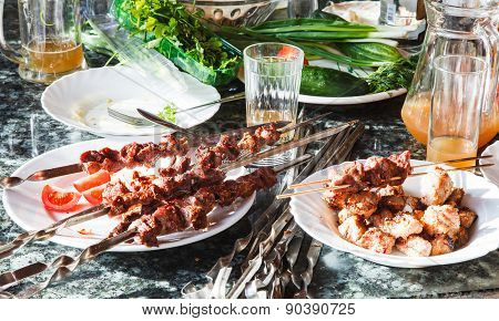Table With Shish Kebabs And Vegetables