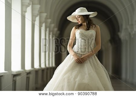 Young Woman In White Long Dress And Hat
