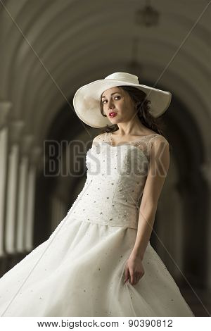 Young Woman In White Long Dress And Hat.