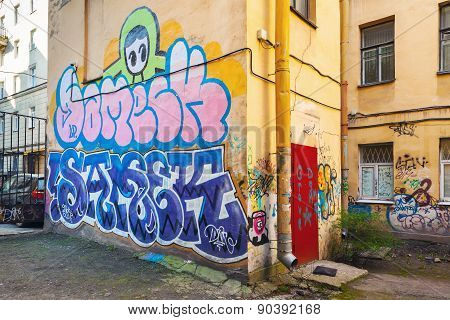 Urban Brick Wall With Colorful Abstract Graffiti