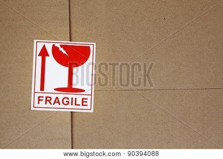 Fragile label on cardboard box