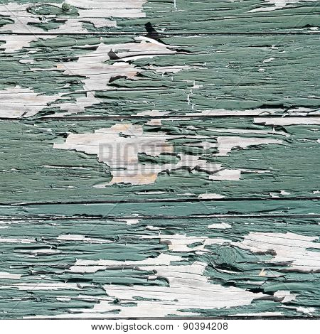 Closeup of green flaking paint texture