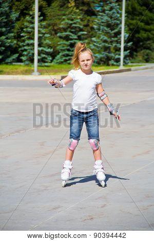 Cute Girl On Roller Skates In Summer