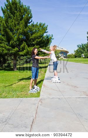 Learning Mother And Daughter On Roller Skates