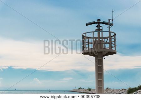 Lighthouse And Breakwater Formed By Concrete Blocks