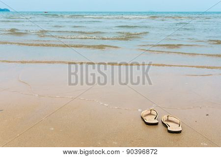 Slipper On Sand Beach And Wave See