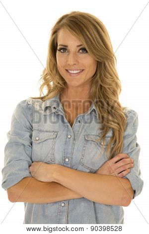 Woman In Blue Shirt Arms Folded Big Smile