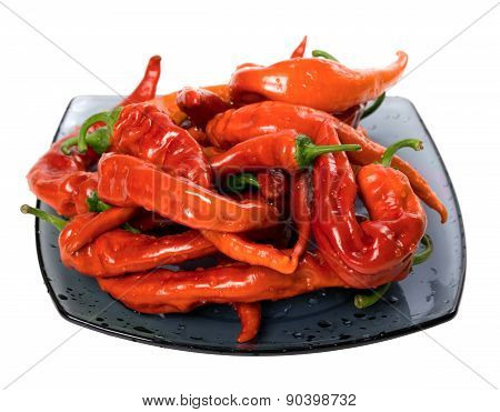 Wet Red Chili Peppers On Glass Plate