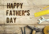 image of carpenter  - Desk of a carpenter with Happy fathers day sign - JPG