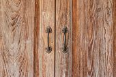 image of door-handle  - Closeup of the old door Handles on wood door - JPG