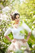 foto of japan girl  - Portrait of beautiful girl posing outdoor with flowers of the cherry trees in blossom during a bright spring day - JPG