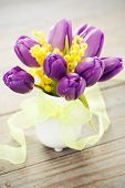 pic of mimosa  - Bouquet of purple tulips and mimosa in vase on wooden background toned - JPG