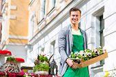 pic of viola  - Young handsome florist delivering palette of flowers or viola - JPG