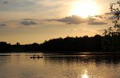 picture of kayak  - Two kayakers sail into the beautiful sunset  - JPG