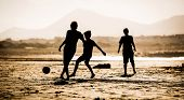 picture of children beach  - Silhouette of children on the beach with a ball - JPG