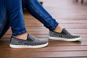 pic of flat-foot  - Man using flat shoes with spikes - JPG