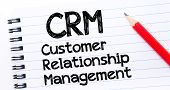 picture of customer relationship management  - CRM acronym as Customer Relationship Management Text written on notebook page red pencil on the right - JPG