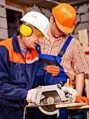 foto of millwright  - Two men  builder with circular saw - JPG
