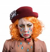 foto of clown face  - Theatrical sad and depressed girl clown crying - JPG