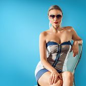 foto of sun-tanned  - Portrait of young beautiful woman in sun glasses with perfect tanned skin - JPG