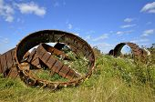 picture of scrap-iron  - Huge steel wheels are propped against each other in a junkyard and scrap metal company - JPG
