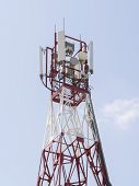 picture of antenna  - Mobile phone communication repeater antenna tower in blue sky - JPG