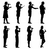 picture of karaoke  - Black silhouettes of mans and womans singing karaoke on white background - JPG