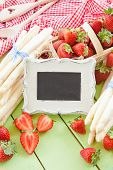 stock photo of white asparagus  - White asparagus and fresh strawberries in early summer season - JPG