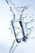 picture of freeze  - Fresh drink with splashing stream of water shot on freeze motion - JPG