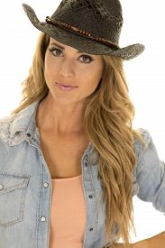 foto of cowgirl  - A cowgirl with a small smile and her western hat on her head - JPG