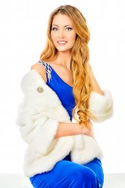picture of mink  - Stunning young woman posing in fashionable dress and mink fur jacket - JPG