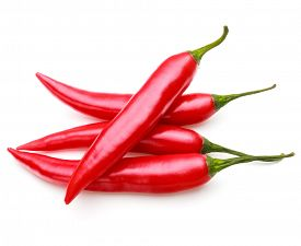 image of red hot chilli peppers  - red chili or chilli cayenne pepper isolated on white  background cutout - JPG